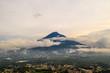 Aerial of Agua volcano near Antigua, Guatemala among clouds