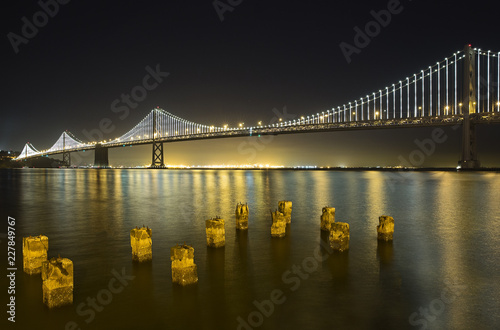 Bay Bridge in San Francisco light up with evening commuters
