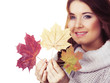 Smiling woman holding colorful maple leaves