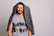Quadro Studio shot of happy handsome man smiling with jacket hanging on