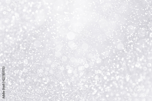 Silver and white snow confetti sparkle background