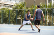 young asiian men playing basketball