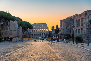 Sunrise in Rome, Italy. View of the Colosseum from Roman street in morning Rome-Italy.