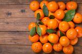 Fresh mandarin oranges fruit or tangerines with leaves, top view