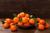 Fresh mandarin oranges fruit or tangerines with leaves in a bowl