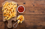 French fries with ketchup, top view - 227888180