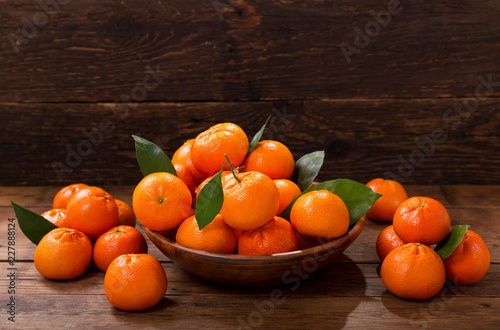 Sticker Fresh mandarin oranges fruit or tangerines with leaves in a bowl