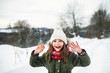 Portrait of a small girl in winter nature, wearing coat, hat and scarf.