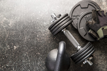 Dumbbell and fitness gloves.