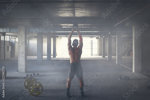 Sticker Athlete is engaged in crossfit in brutal gym