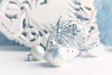 Vintage Christmas ornament. White - Silver Christmas balls.  Symbolic image. Christmas background. White - blue background. Close up. Copy space.  - 227899570