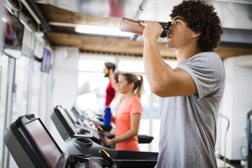 Young handsome man doing cardio training in gym © nd3000