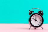 black vintage alarm clock on color background - 227904106
