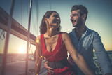 happy couple taking a romantic cruise on the sail boat - 227908753