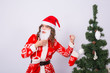 Joke, holidays and christmas concept - angry woman in santa costume with fake beard on white background