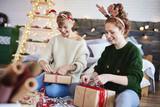 Happy girls making christmas presents