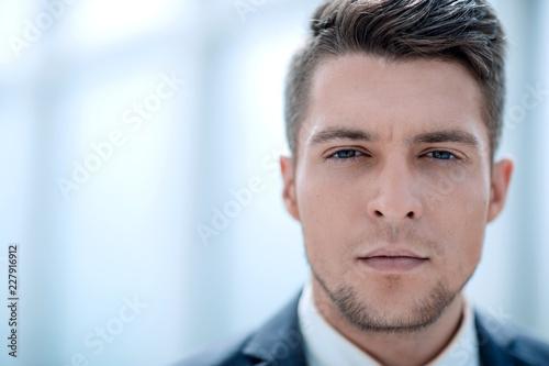 Leinwandbild Motiv Close up portrait of serious businessman
