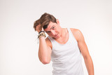 Style and people concept - handsome man correct his hairstyle over the white background