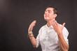 Leinwandbild Motiv Emotions, gesture and people conecpt - Handsome man in white shirt over grey background