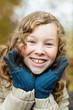 Leinwandbild Motiv Outdoor portrait of happy blond girl
