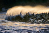 lonely wave breaking at sunset - 227953997