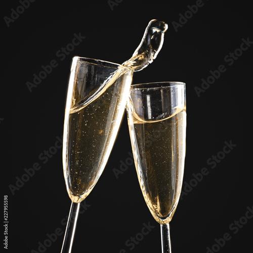 Leinwanddruck Bild Glasses of champagne with splash