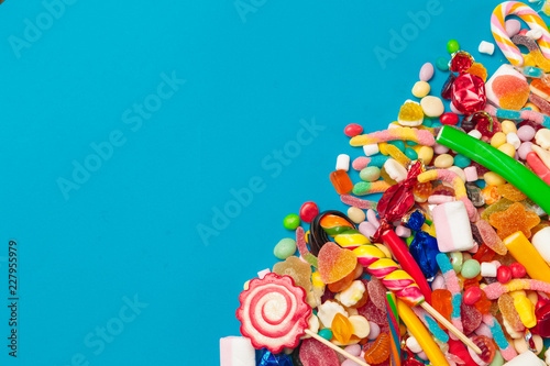 colored candies on blue background