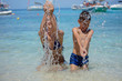 Quadro Happy child playing in the sea. Kid having fun outdoors
