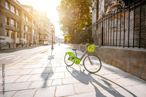 View on the street with green bicycle near the Notre-Dame cathedral in Paris