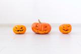 Halloween pumpkins. Funny Jack O'Lantern on the light room - 227977369