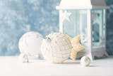 Vintage Christmas ornament. White - Silver Christmas balls.  Symbolic image. Christmas background. White - blue background. Close up. Copy space.  - 227986129