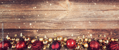 Leinwanddruck Bild christmas background with red and golden decorations