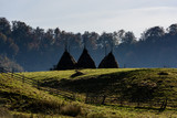 Autumn landscape in the mountains with stack of hay. Traditional hay stacks, typical rural scene of Romania.  - 227989548