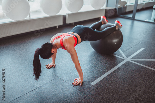Sticker Anonymous woman doing plank on ball