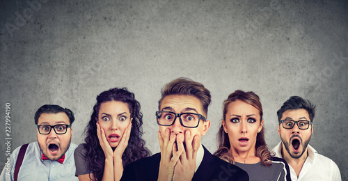 Shocked man in glasses and his scared friends