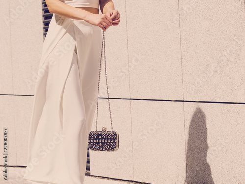 Woman wearing purse and culottes