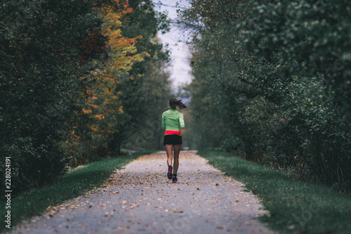 woman running in automn