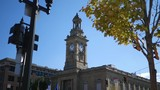 Establishing shot of a clock tower in small town in autumn - 228050371