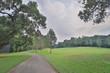 walk way and green field at golf club