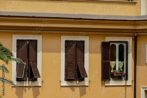 Foto Murales window with shutters, digital picture taken in Italy, Europe