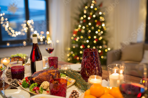 christmas dinner and eating concept - food and drinks on table at home - 228065961