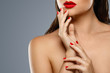 Quadro Beauty and cosmetics. Female mouth and nails with red manicure and lipstick.