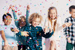 Quadro Smiling multicultural group of kids having fun with confetti during friend's birthday