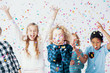 Quadro Happy girls and boys having fun together during birthday party with confetti