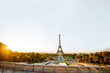 Landscape view on the Eiffel tower from Trocadero square during the sunrise in Paris