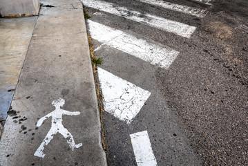 little man crosses pedestrian crossing