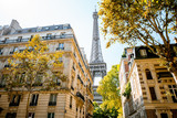 Beautiful street view with old residential buildings and Eiffel tower during the daylight in Paris - 228080398