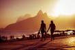 Quadro Scenic golden sunset view of Ipanema Beach with shadow silhouettes walking on the Arpoador boardwalk in Rio de Janeiro, Brazil