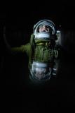 Boy wearing old space helmet lost in the dark