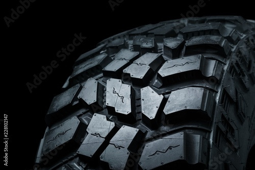 New Car Tires on black  background - 228102147
